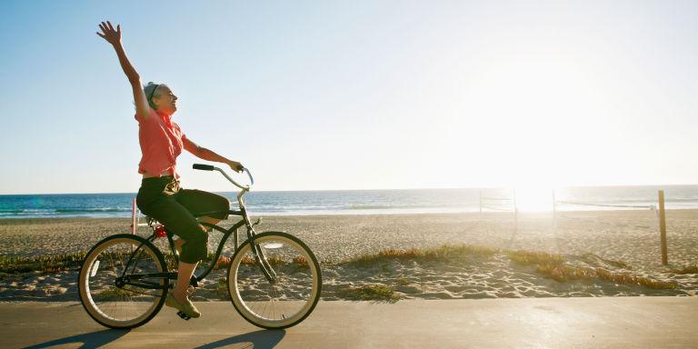 Woman riding bike at the beach