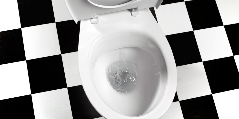black and white toilet seat. White toilet with seat up  black and white tiles underneath Behavioural therapy for urinary incontinence
