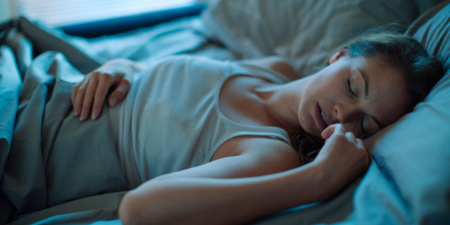 Woman sleeping at night in bed
