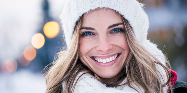 Woman smiling in winter clothing