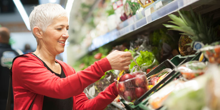Mature woman shopping at supermarket