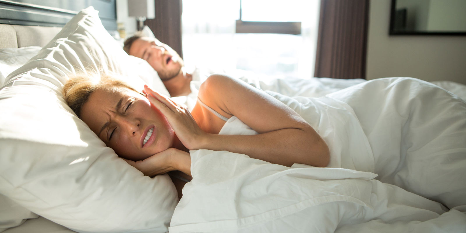 Men And Women In Bedroom What Is Insomnia Expert Advice On Managing The Condition