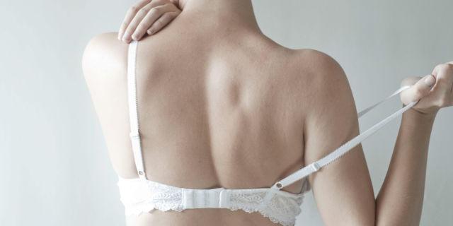 Woman taking bra off