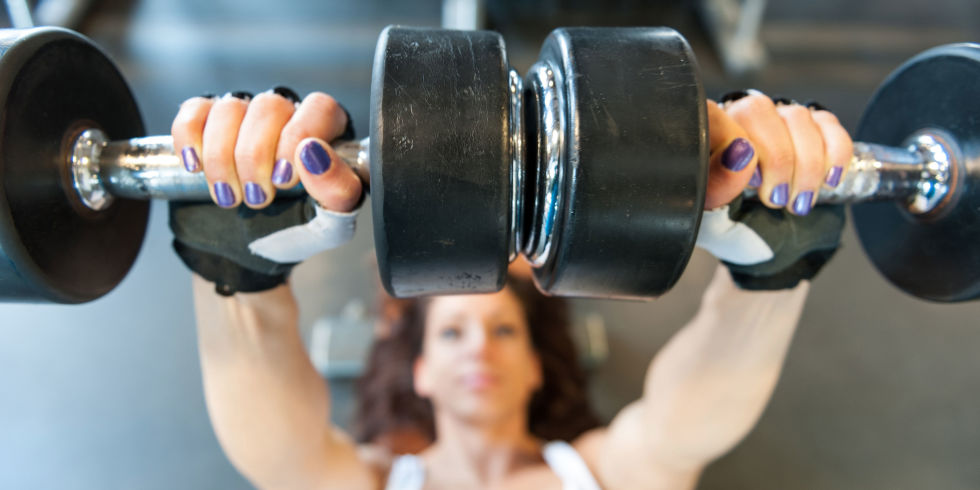 Woman Lifting Weights Painted Nails