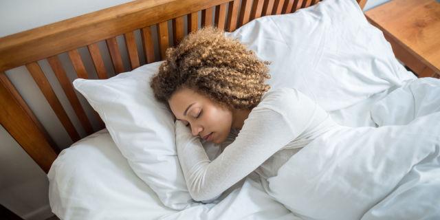 Sleeping woman in bed asleep