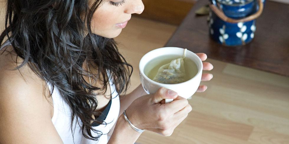 Woman drinking detox tea