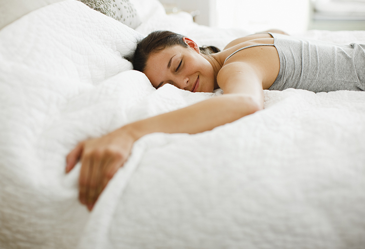 Woman sleeping in yearner position