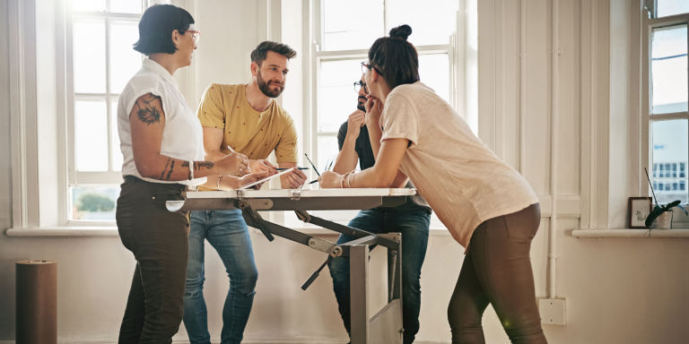Group of people at standing desk