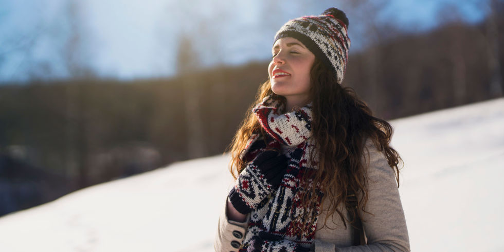 Beautiful young woman enjoying a carefree winter day in the nature.