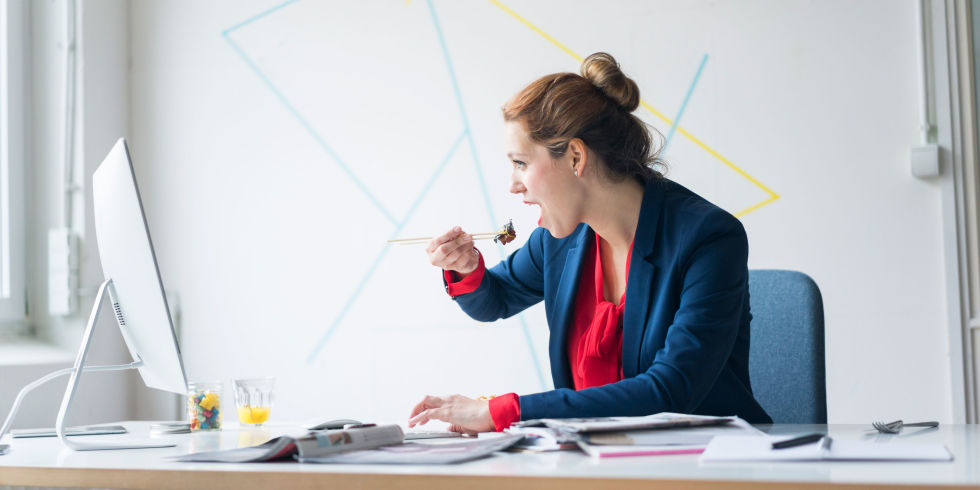 Woman eating lunch at desk